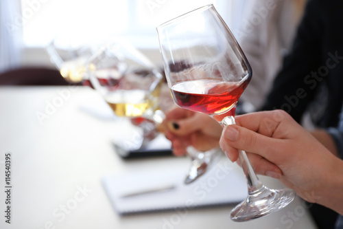 Experts tasting new sorts of wine at the table