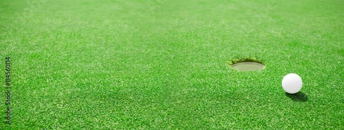 Spoed Foto op Canvas Golf Golf ball at the edge of the hole