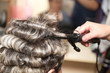 wrap hair curling in a beauty salon