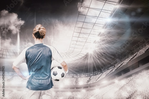 Composite image of rear view of woman football player posing