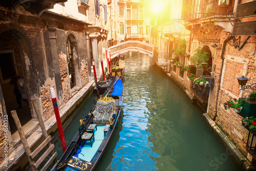 Photo  Canal with gondola in Venice, Italy