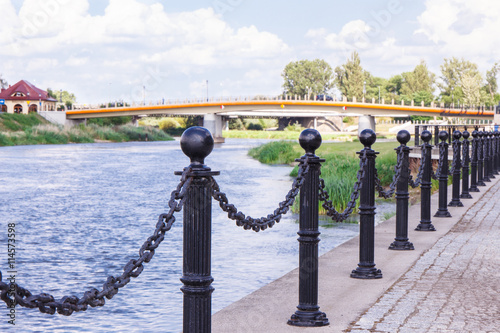 Spoed Foto op Canvas Stad aan het water Konin, Poland - June 18, 2016: Embankment of polish Warta river in town Konin