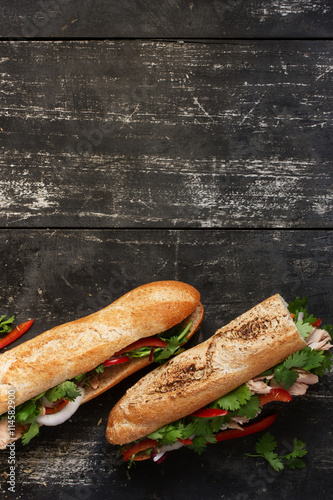Staande foto Snack Two tuna sandwich on dark wood background