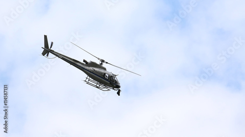 Tuinposter Helicopter helicopter flying in the sky with the camera for TV top