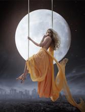 Elegant Woman Over Big Moon Ba...