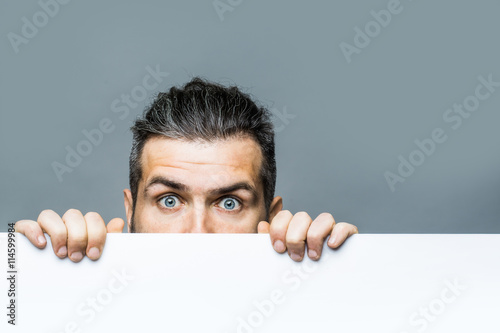 scared man with paper Wallpaper Mural