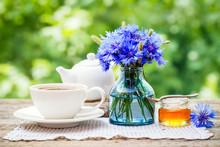Tea Cup, Teapot, Honey Jar And Summer Bouquet Of Blue Cornflower