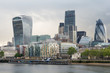 Futuristic skyscrapers in city of london on a cloudy day along river Thames