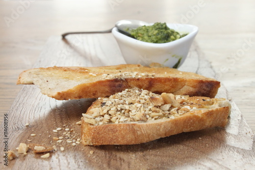 fototapeta na drzwi i meble ciabata bread with dukkah and basil pesto