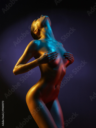 fashion art photo of sexy nude stripper in the night-club плакат