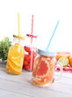 Jar with fresh fruit juice and straw