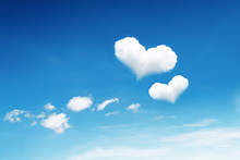 Two Heart Clouds On Blue Sky