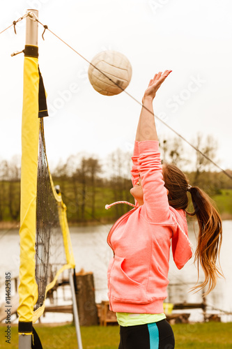 fototapeta na drzwi i meble Woman volleyball player outdoor on court