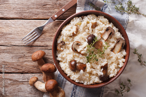 risotto with porcini mushrooms and thyme close-up. horizontal top view