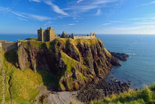 Dunnottar Castle with blue sky background in Aberdeen, Scotland. Wallpaper Mural