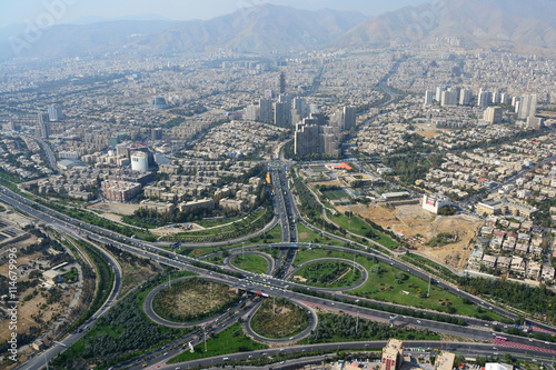 Road junction and buildings in north Tehran, Iran