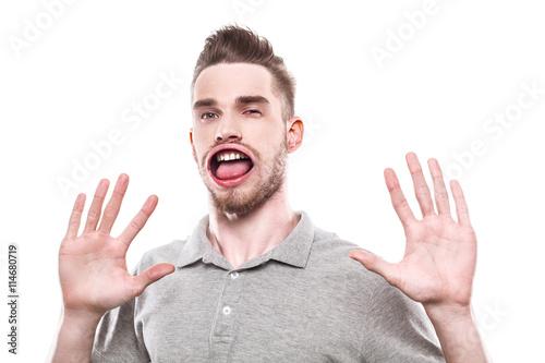 Young man with windblown mouth Billede på lærred