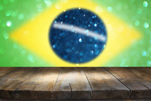Empty Table In Front Of Abstract Brazil Flag Background