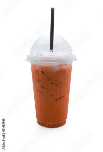 Keuken foto achterwand Milkshake Thai tea in plastic glass and black straw isolated on white background