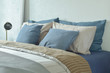 Blue and gray color scheme bedding with reading lamp