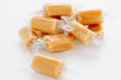 Individually wrapped caramel or fudge candy pieces