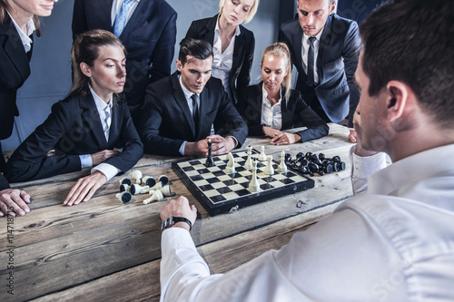 Business people playing chess Wallpaper Mural