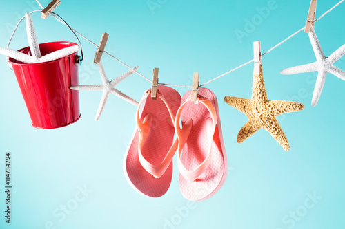 Summer theme with sandals, pail and starfish Poster