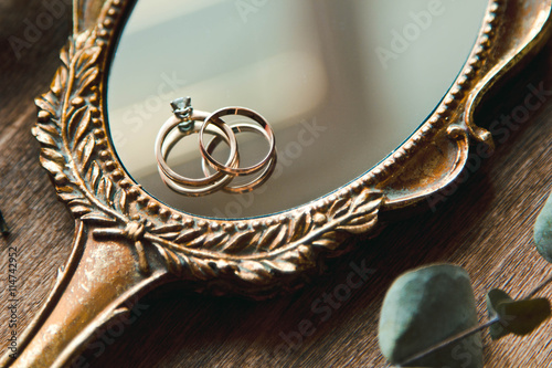 Beautiful wedding rings on a vintage mirror Canvas Print