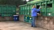 Woman recycling plastics at a collection site