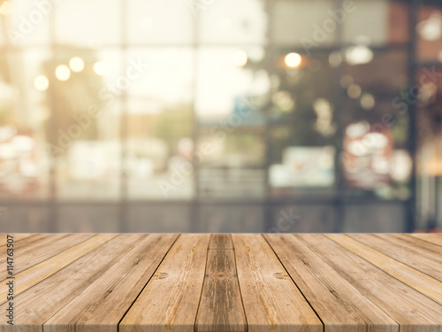 Fényképezés  Wooden board empty table in front of blurred background