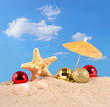 Christmas decorations seashells and starfish on a beach sand