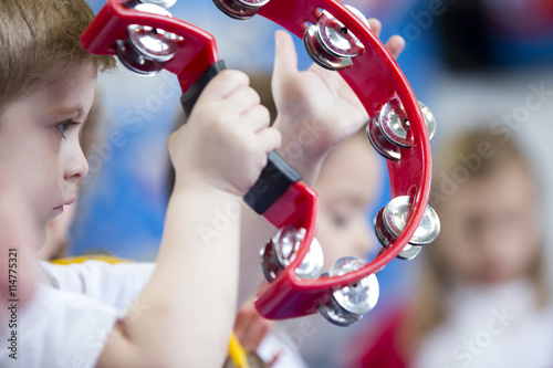 Fotomural Boy Playing Tambourine at Nursery