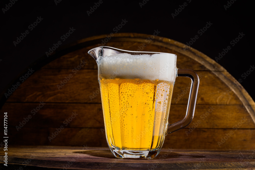 Fototapety, obrazy: Pitcher of beer on wooden background
