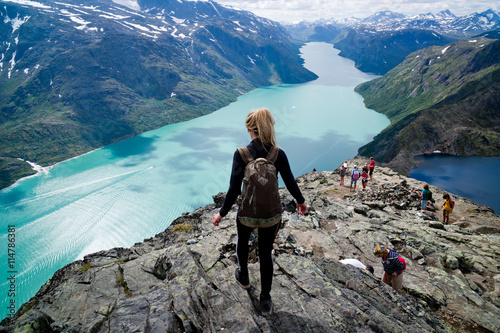 Obraz Blond, young woman hiking  Besseggen, Jotunheimen, - fototapety do salonu