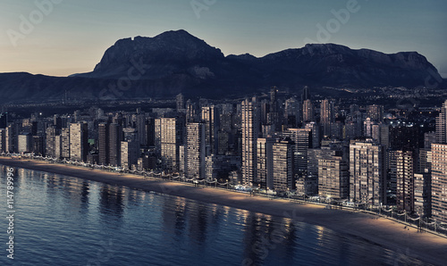Aerial view of a Benidorm city coastline at sunset. Spain
