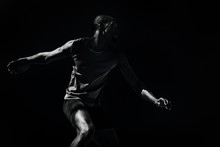 Composite Image Of Athlete Man Throwing A Discus
