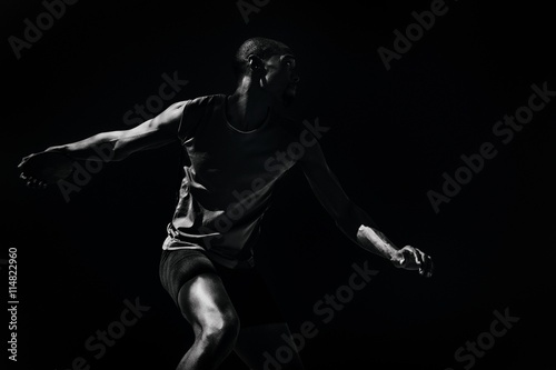 Fotografie, Obraz  Composite image of athlete man throwing a discus
