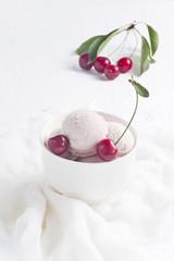 Vanilla and cherry ice cream with cherries.