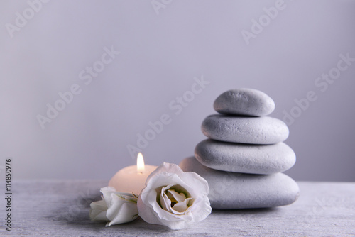 White spa stones with candle on gray background Canvas Print