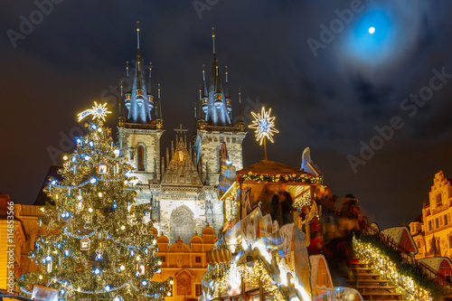 Poster Prague Old Town Square with Christmas tree and fairy tale Church of our Lady Tyn in the magical city of Prague at moonlight night, Czech Republic