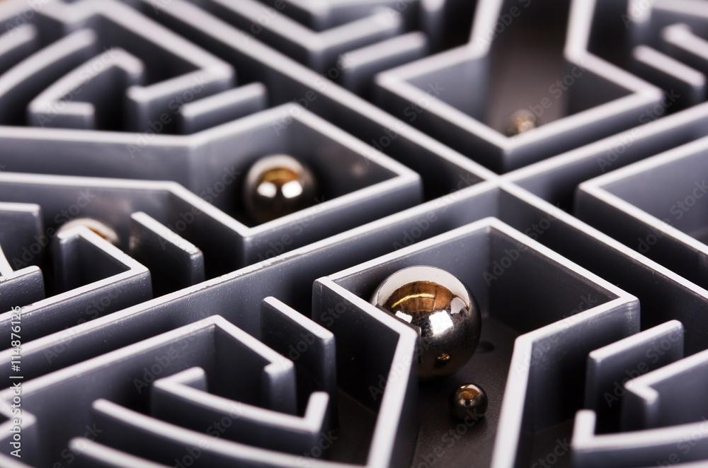 Fototapeta Close up of a grey labyrinth or maze