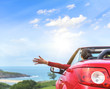Girl in a red convertible car.