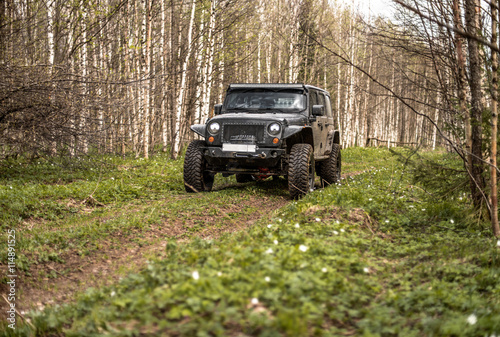 Valokuva  off-road extreme expedition on black jeep wrangler