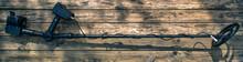 Metal Detector On Wood Background