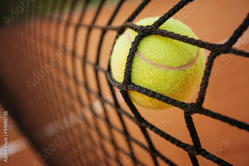 Photo  Tennis ball in net