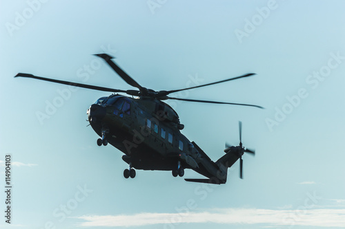 Tuinposter Helicopter Military helicopter in the sky,close up of a military helicopter in flight