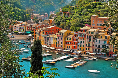 Portofino with boats and yacht in little bay harbor. Liguria, Italy