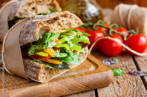 Tuinposter Snack veggie sandwich with vegetables and pesto