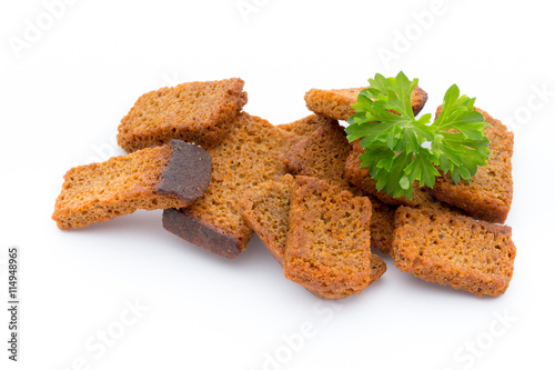 Fotografía  Bread croutons isolated on a white background.