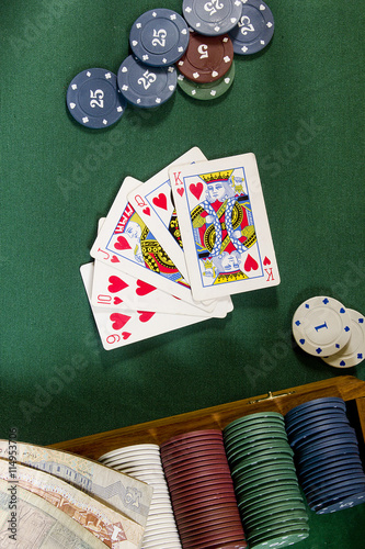 Cards with poker hand with chips and money плакат